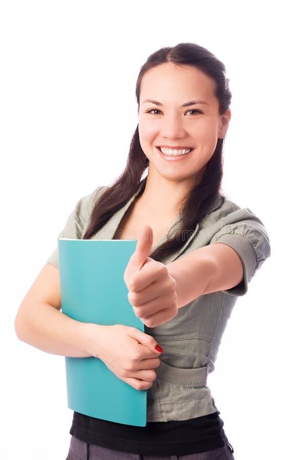 счастливо ее большой пец руки студента вверх стоковое фото