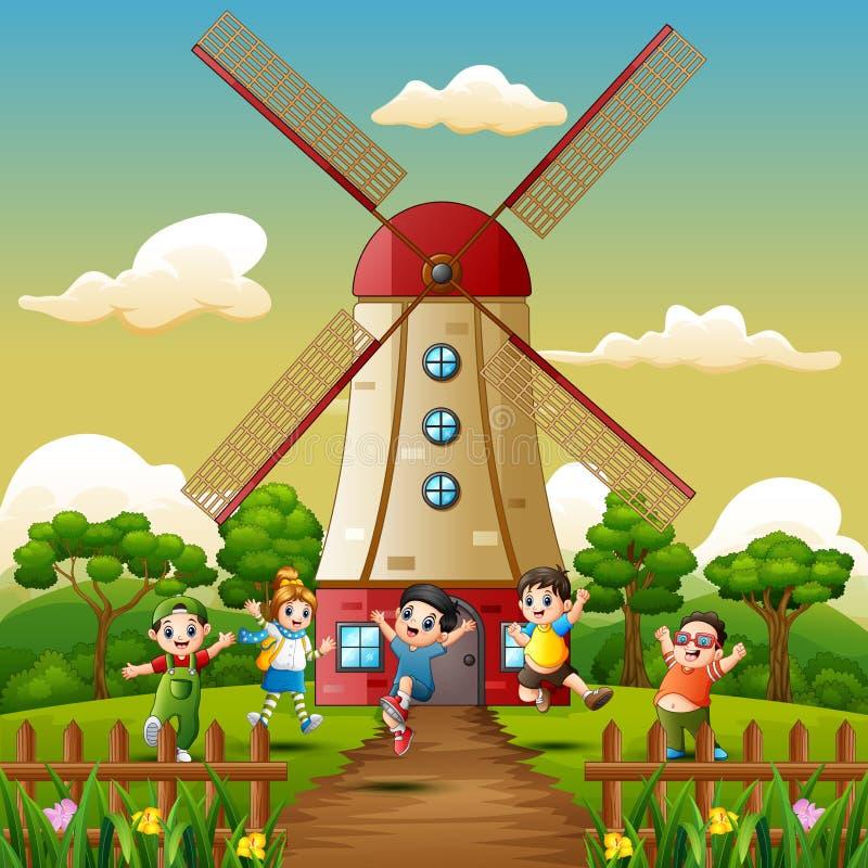 Счастливые дети играя перед предпосылкой здания ветрянки бесплатная иллюстрация