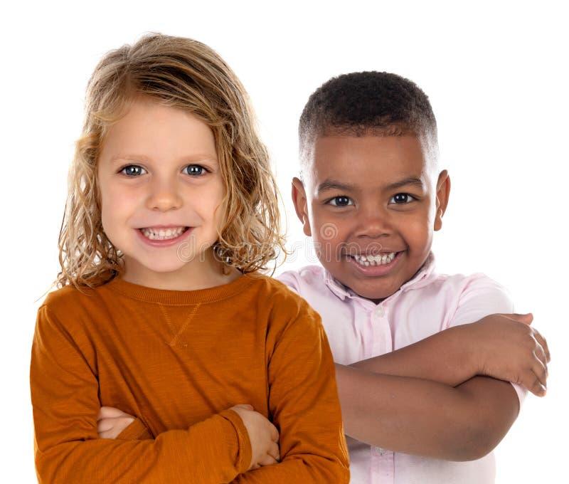 Счастливые дети смотря камеру стоковое изображение rf
