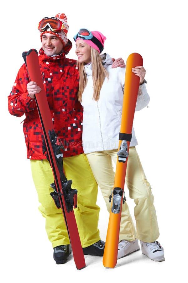 счастливые лыжники стоковое фото