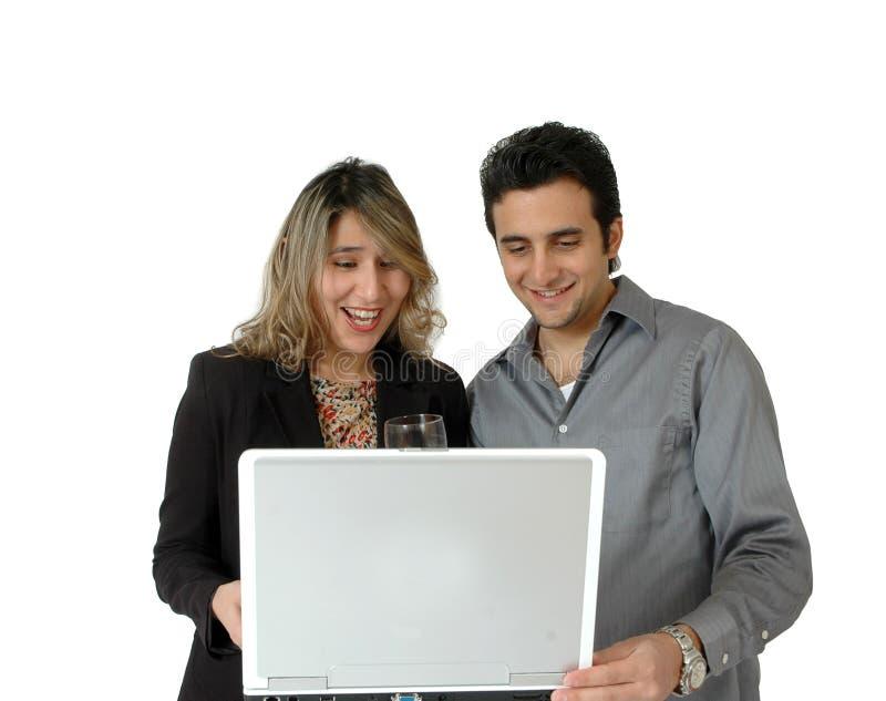 счастливые он-лайн покупатели стоковые фото