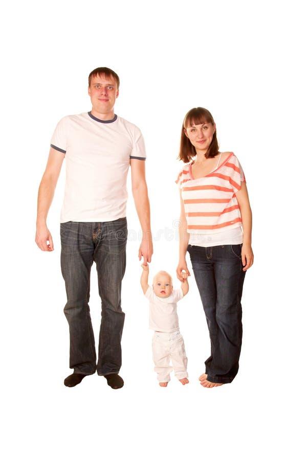 Счастливые отец, мать и младенец стоковое фото