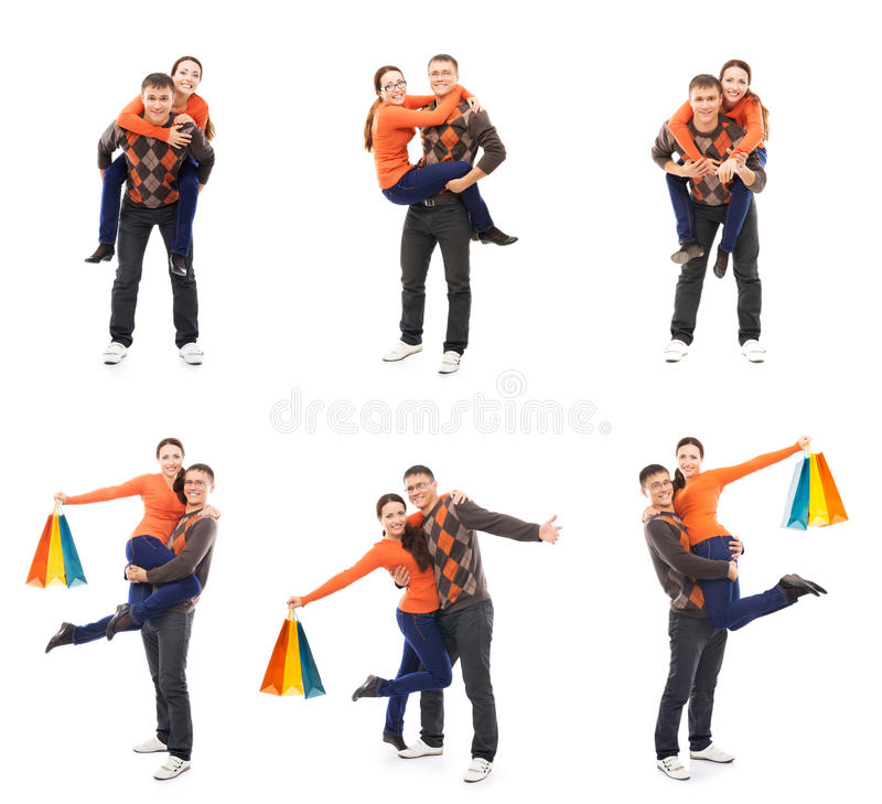 Счастливые пары делая покупки изолированные на белизне стоковые фотографии rf