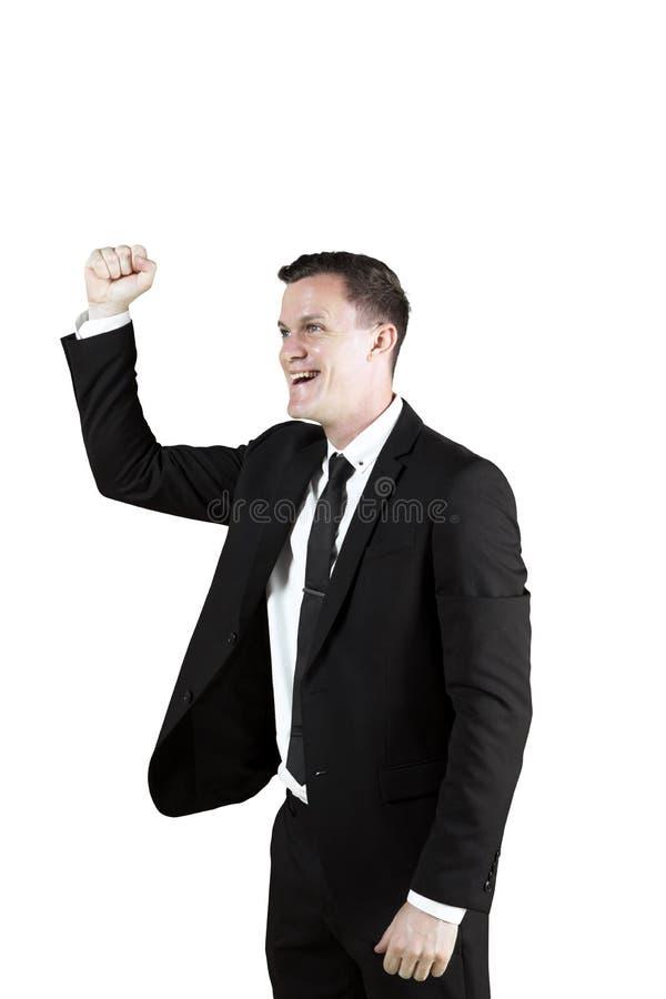 Счастливый бизнесмен выражая его успех на студии стоковое изображение