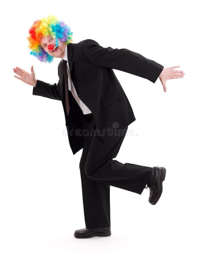 Счастливый бизнесмен с париком клоуна стоковая фотография rf