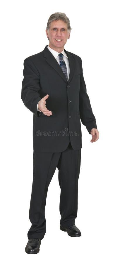 Счастливый бизнесмен с усмешкой, трястиет изолированные руки, стоковые изображения