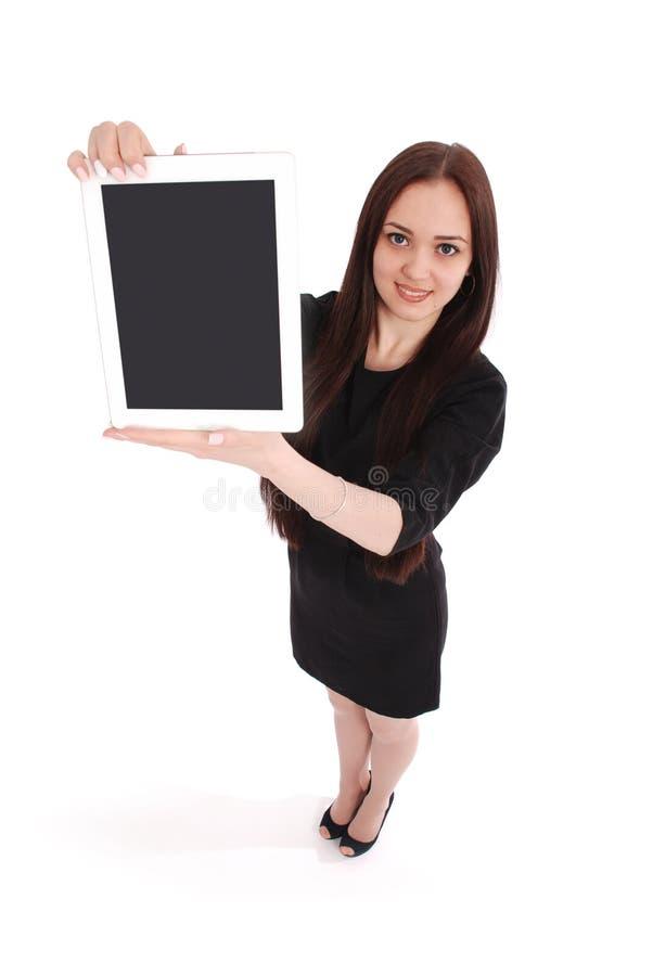 Счастливый взгляд девочка-подростка студента сверху и показывающ таблетку стоковое изображение rf