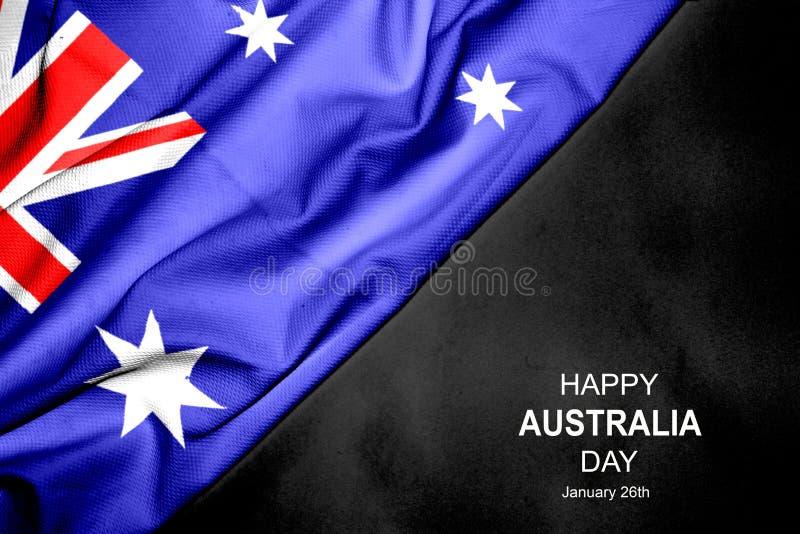 Счастливый день Австралии - 26-ое января Австралийский флаг на темной предпосылке стоковая фотография