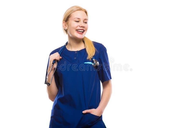 Счастливый доктор женщины в сини scrubs стоковое фото