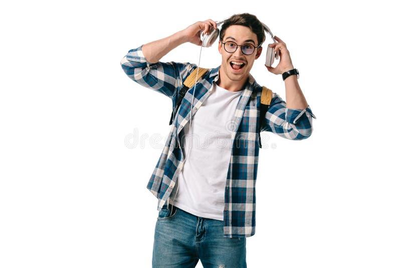 счастливый красивый студент слушая к музыке стоковая фотография rf