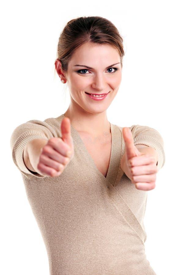 счастливый показывая большой пец руки знака вверх по детенышам женщины стоковая фотография rf