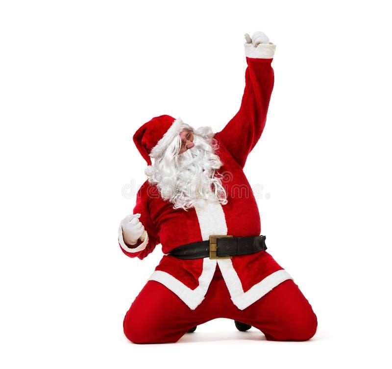 Счастливый Санта Клаус сползая на колени изолированные на белом backgro стоковое фото rf