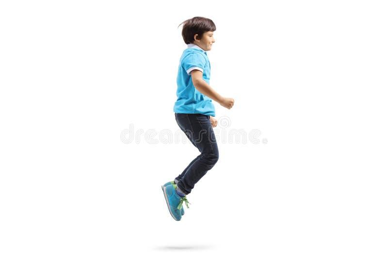 Счастливый скакать мальчика стоковое фото rf