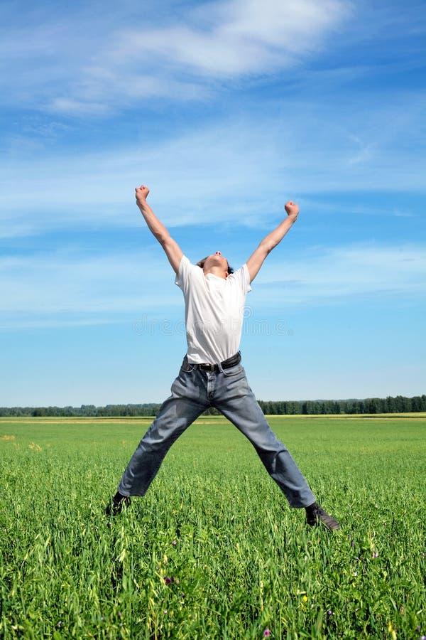 Счастливый скакать персоны стоковая фотография rf