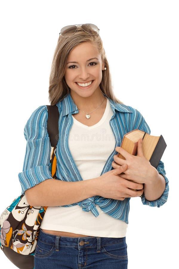 Счастливый студент с книгами стоковые фотографии rf