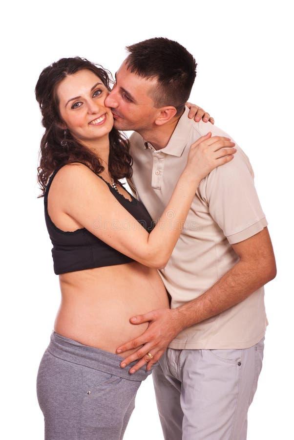 Счастливый целовать семьи стоковое изображение rf