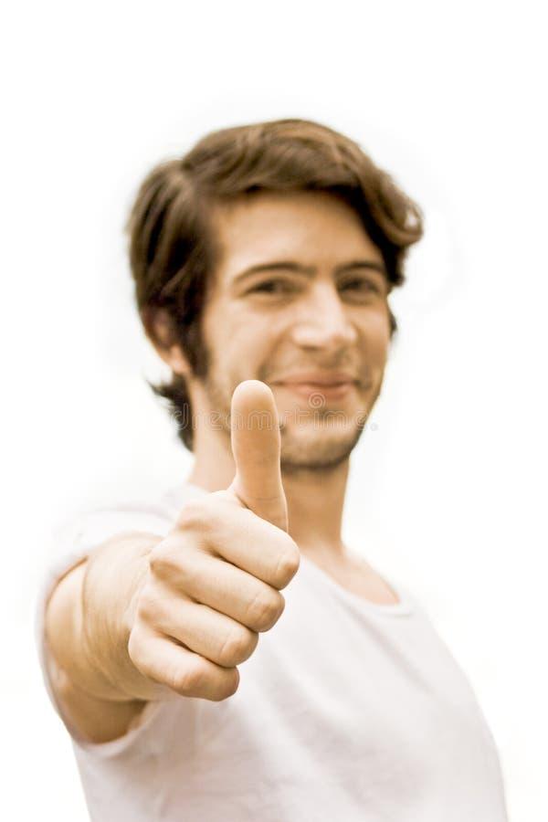 Счастливый человек с большим пальцем руки вверх стоковые фото