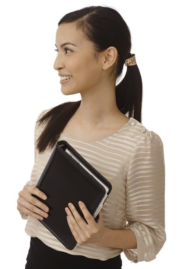 Счастливая азиатская коммерсантка смотря правый стоковые изображения rf