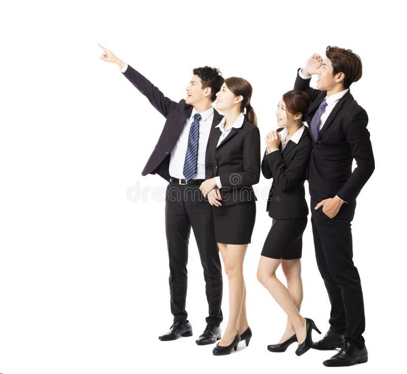 Счастливая бизнес-группа указывая и смотря вверх стоковое фото rf