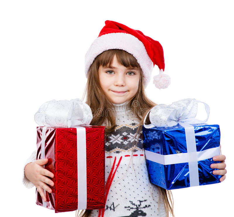 Счастливая девушка в красной шляпе santa держа подарочные коробки Изолированный на whit стоковая фотография rf