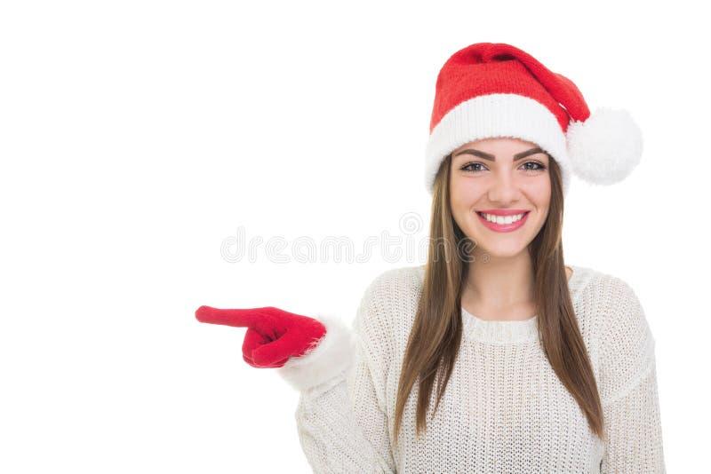 Счастливая девушка Санты указывая налево стоковые изображения rf