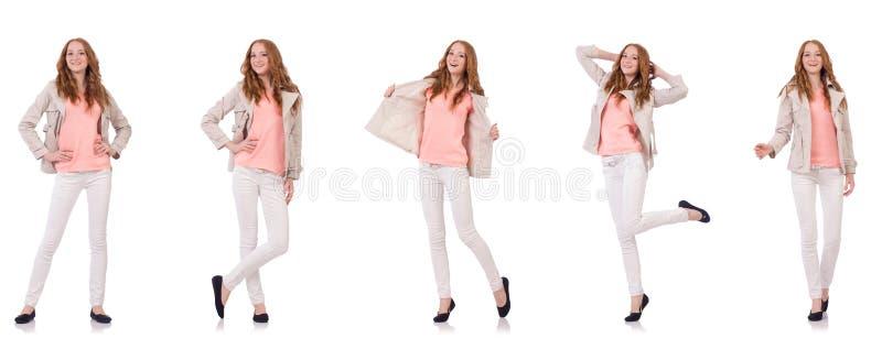 Счастливая женщина в одежде зимы изолированной на белизне стоковые изображения