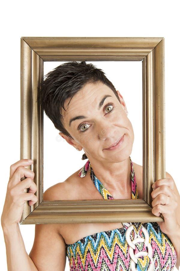 Счастливая женщина в рамке стоковое изображение