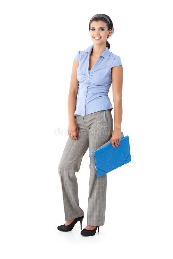 Счастливая женщина держа папки стоковые изображения rf