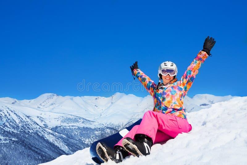 Счастливая женщина сноуборда стоковая фотография rf