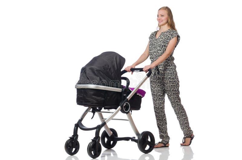 Счастливая мама с ее младенцем в pram стоковые фото