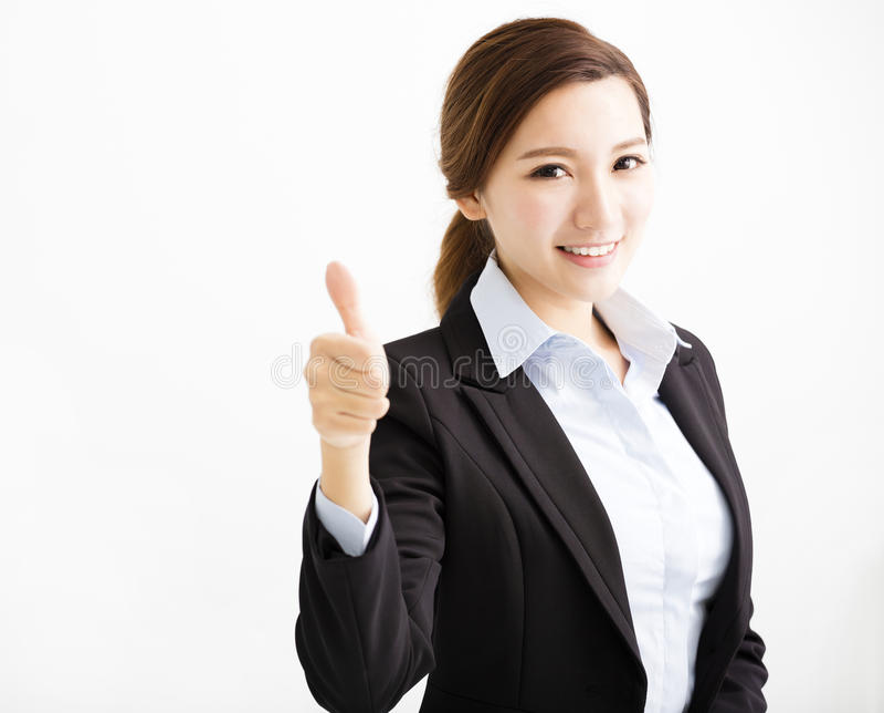 Счастливая молодая бизнес-леди с большим пальцем руки вверх стоковое изображение rf