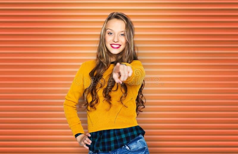 Счастливая молодая женщина или предназначенный для подростков указывая палец к вам стоковые изображения rf
