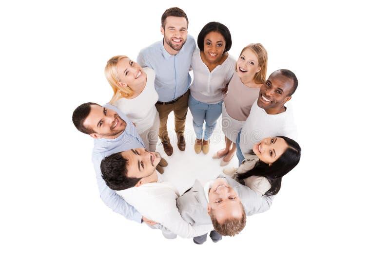Счастливая объединенная команда стоковое изображение rf