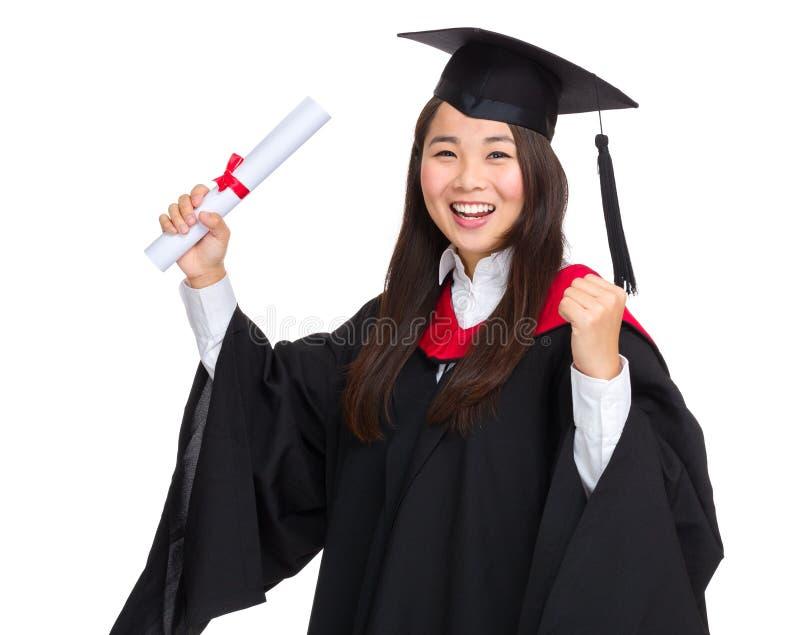 Счастливая постдипломная девушка стоковое фото