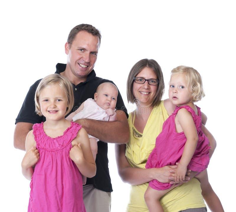 Счастливая семья, изолированная на белизне стоковое изображение