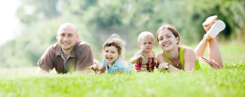 Счастливая семья из четырех человек стоковое фото rf