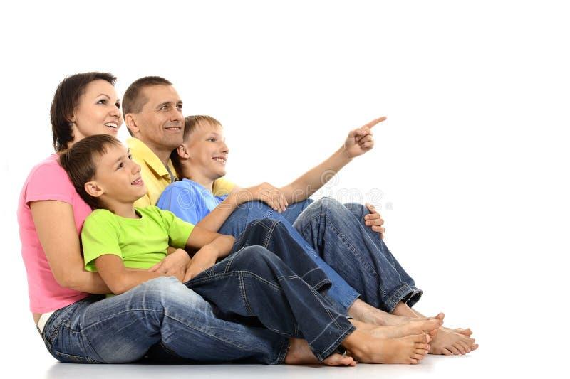 Счастливая семья на белизне стоковая фотография rf