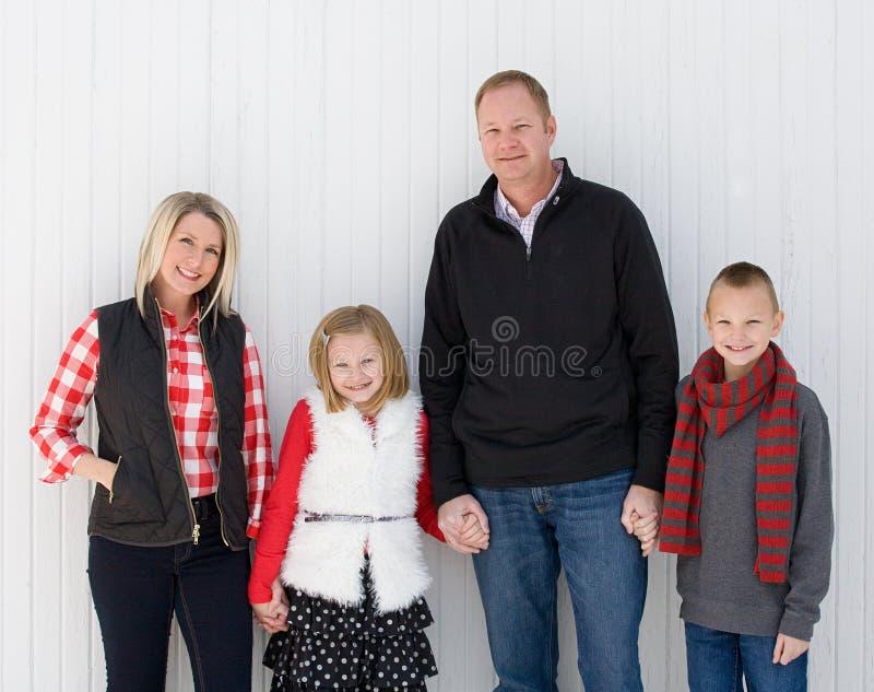 Счастливая семья на рождестве стоковое изображение