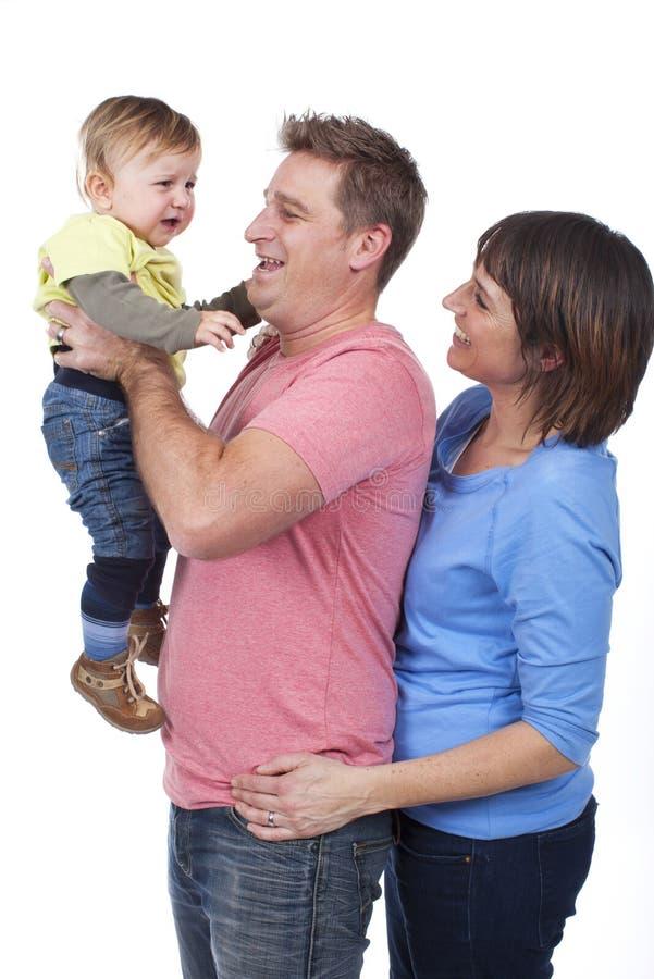 Download Счастливая семья с малышом стоковое изображение. изображение насчитывающей вакханические - 37926341