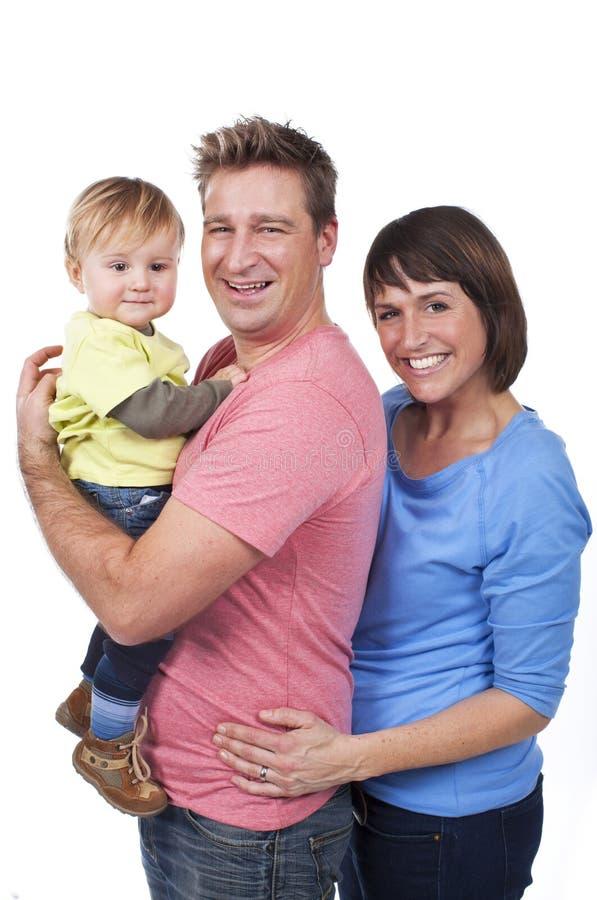 Download Счастливая семья с малышом стоковое фото. изображение насчитывающей малыши - 37926378