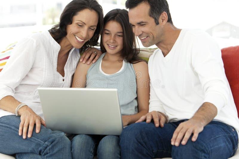 Счастливая семья с одним ребенком стоковое фото