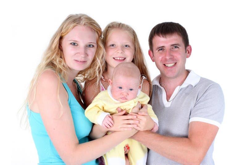 Счастливая семья с 2 сестрами стоковая фотография