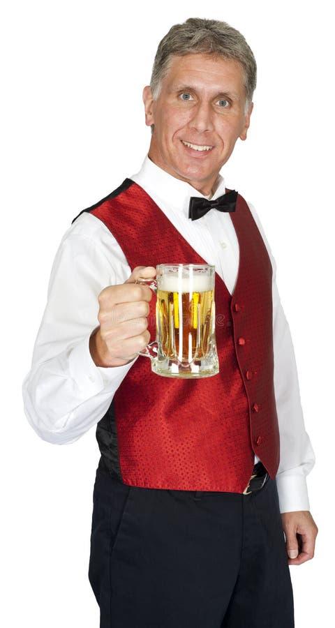 Счастливое изолированное пиво сервировки бармена стоковое изображение rf