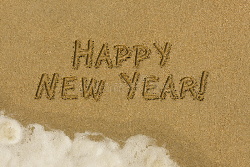 Счастливое сообщение Нового Года в песке стоковая фотография rf
