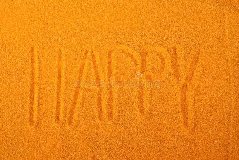 Счастливое сочинительство песка стоковое фото rf