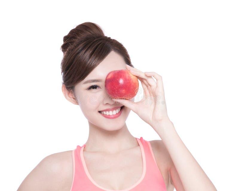 Счастливое яблоко выставки женщины здоровья стоковая фотография rf