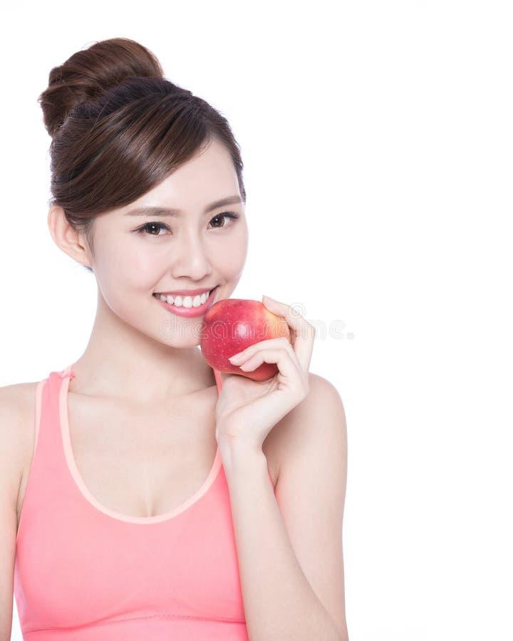 Счастливое яблоко выставки женщины здоровья стоковое изображение rf