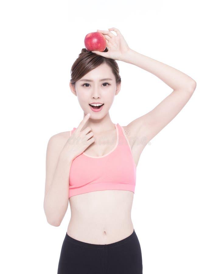 Счастливое яблоко выставки женщины здоровья стоковые изображения