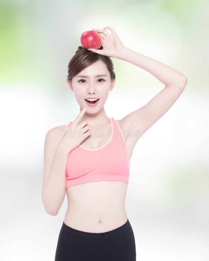 Счастливое яблоко выставки женщины здоровья стоковое фото rf