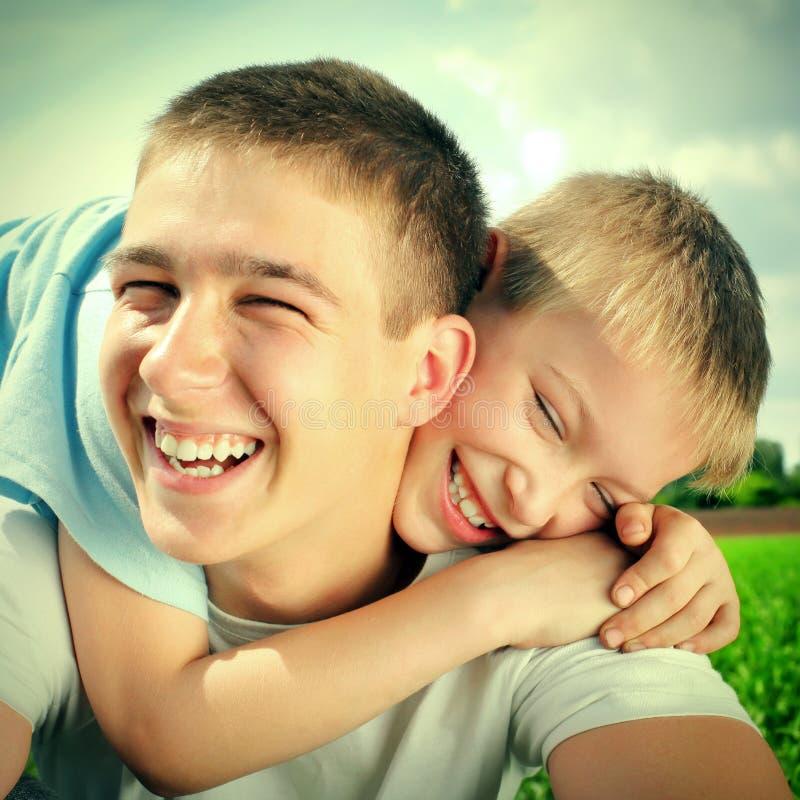 Счастливые братья стоковое фото rf